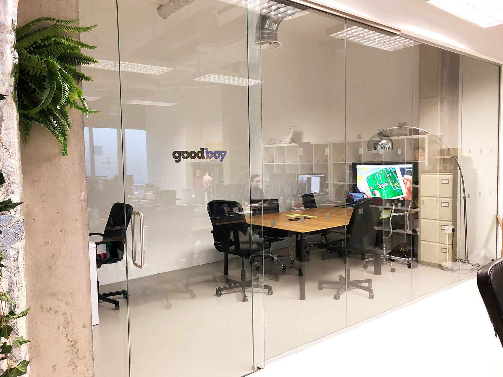 Glass partitioning at goodboy digital ltd london top for Top hung sliding glass doors