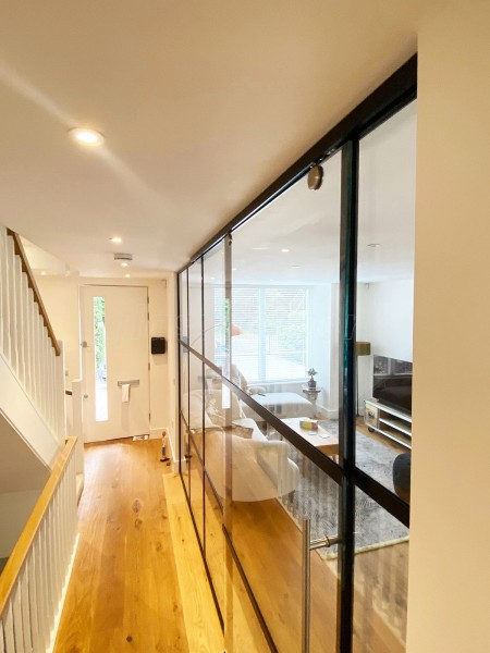 AOD Contracts (Twickenham, London): Industrial Style Interior Glass Wall With Large Sliding Door
