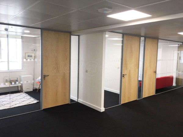 Above & Beyond Construction Ltd (Haymarket, London): Multi-Office Full Floor Fit-Out with Timber Doors & Toughened Glass Partitions