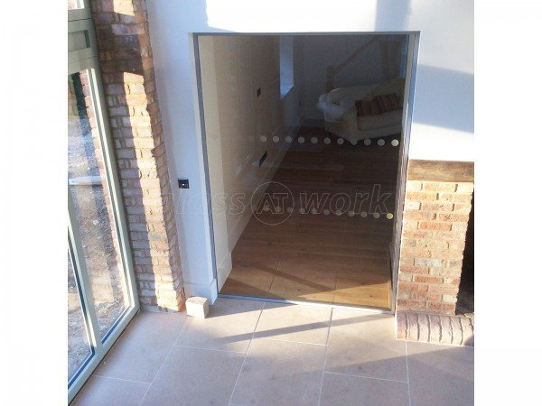 Martin Haynes Construction, Domestic (Towcester, Northamptonshire): Frameless Glass Door and Wall Around Central Fireplace