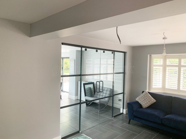 Domestic Project (Ampthill, Bedfordshire): Slimline T-Bar Black Framed Glazing With Frameless Glass Sliding Doors