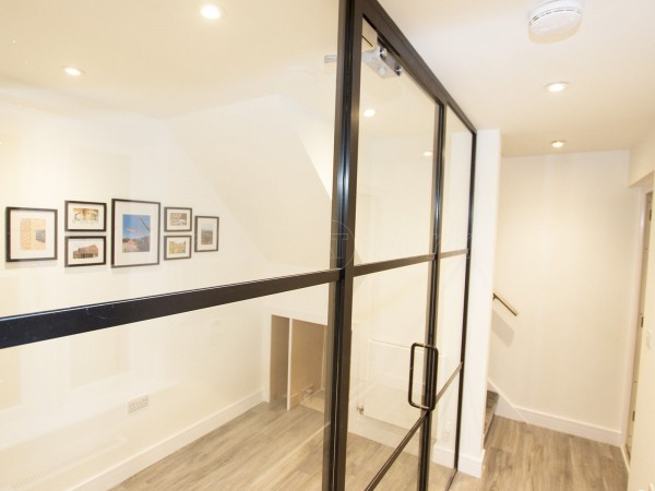 Symonds Newey (Leamington Spa, Warwickshire): T-Bar Slimline Heritage Style Black Banded Glazed Partition Wall