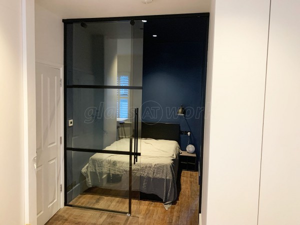 Capital Living (Clapham, London): Industrial-Style Black Metal and Glass Sliding Door For A Bedroom