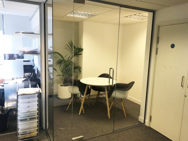 Goodman Masson (Islington, London): Glass L-shaped Partition with Frameless Glazed Door