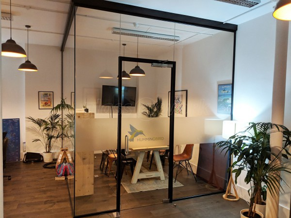 Hummingbird Travel (Brent, London): Corner Glass Meeting Room With Black Track