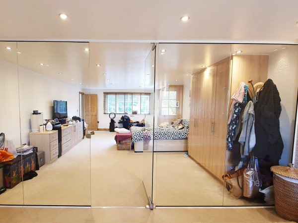Domestic Project (Uxbridge, Middlesex): Frameless Glass Partition with Frameless Toughened Glass Door